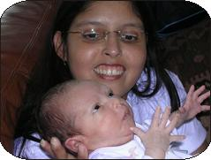 photo of mother holding infant